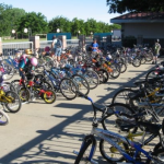 School bike rack showing a lot of student bikes.